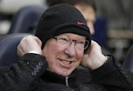 Manchester United manager Alex Ferguson wraps up ahead of the game against Tottenham Hotspur on January 20, 2013. As well as a two-legged tie with Madrid in the Champions League last 16, United are also scheduled to face Reading in the FA Cup, but Ferguson is happy with the depth in his squad
