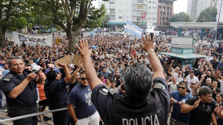 Policemen and their relatives from La Plata, the capital of Buenos Aires province gather during a protest in downtown La Plata