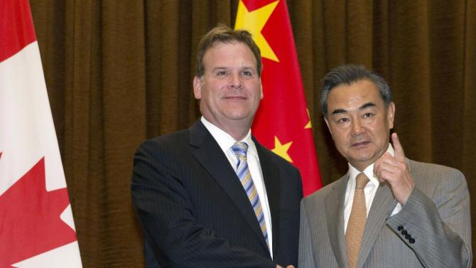 Baird shakes hands with Wang before a meeting at the Foreign Ministry in Beijing