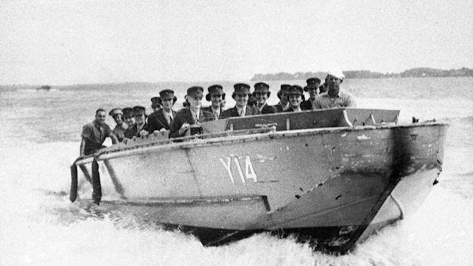 FILE - In this Oct. 2, 1943, file photo, Marine Corps Women Reserves undergoing training at Camp Lejeune, New River, N.C., ride in a landing boat of the type that were used by the Marines in landing operations in the South Pacific. (AP Photo, File)