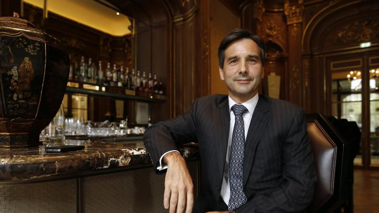 Nicolas Beliard, General Manager of the Peninsula Paris hotel, poses at the bar of the Peninsula Paris luxury hotel in Paris