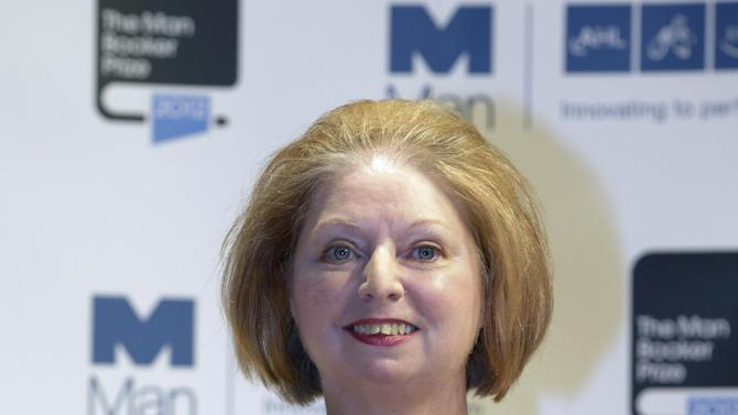 Author Hilary Mantel, shortlisted for the Man Booker Prize, holds a copy of her book 'Bring up the Bodies' during a photo call at the Royal Festival Hall, in London, Monday Oct. 15, 2012. The 50,000 British pounds  (US 80,000 dlrs) prize will be announced Tuesday, Oct. 16, 2012. (AP Photo/Lefteris Pitarakis)