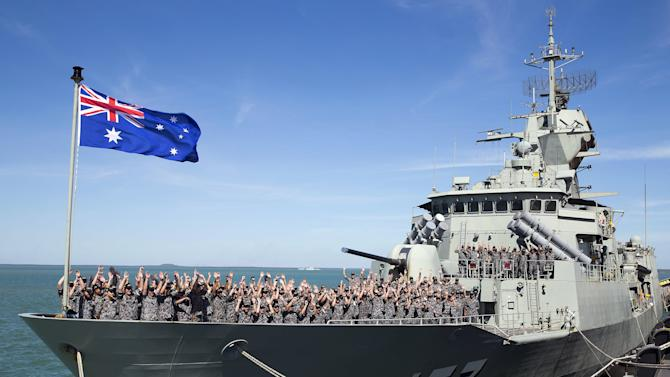 The crew of the Royal Australian Navy Anzac class frigate HMAS Perth cheer as they arrive at the Northern Australian city of Darwin
