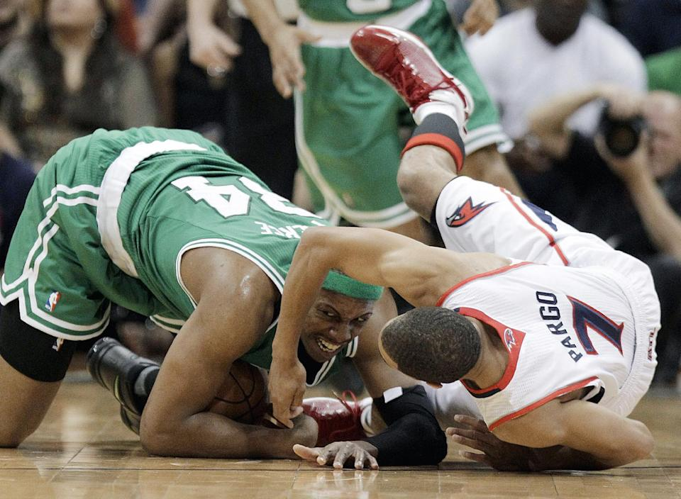 Boston Celtics' Paul Pierce (34) collides with Atlanta Hawks' Jannero Pargo during the second quarter of Game 1 of an opening-round NBA basketball playoff series, Sunday, April 29, 2012, in Atlanta. (AP Photo/David Goldman)