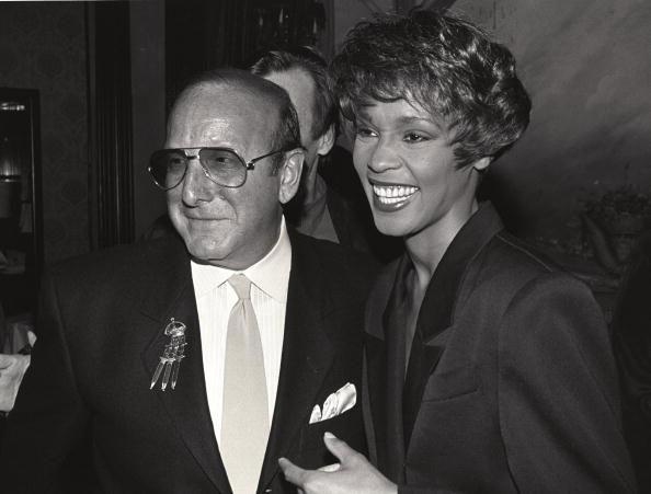 Clive Davis and Whitney Houston in 1990. (Photo by Larry Busacca/WireImage)