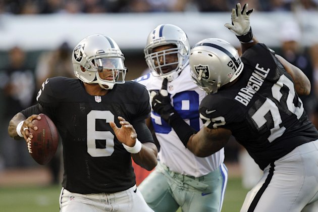 Oakland Raiders quarterback Terrelle Pryor (6) looks to pass as offensive tackle Joe Barksdale (72) blocks Dallas Cowboys defensive end Kenyon Coleman (99) during the second half of an NFL preseason football game in Oakland, Calif., Monday, Aug. 13, 2012. (AP Photo/Ben Margot)