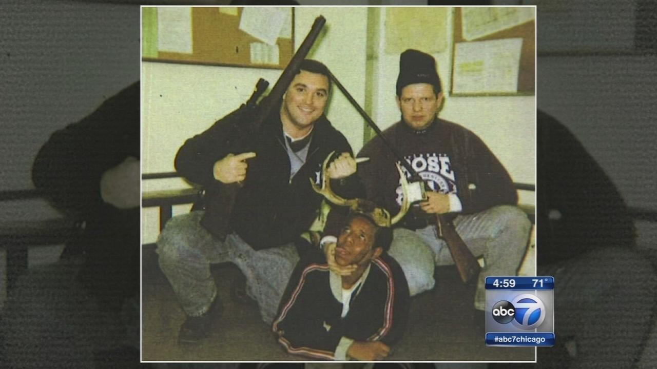 Photo shows Chicago cops posing over black man with antlers