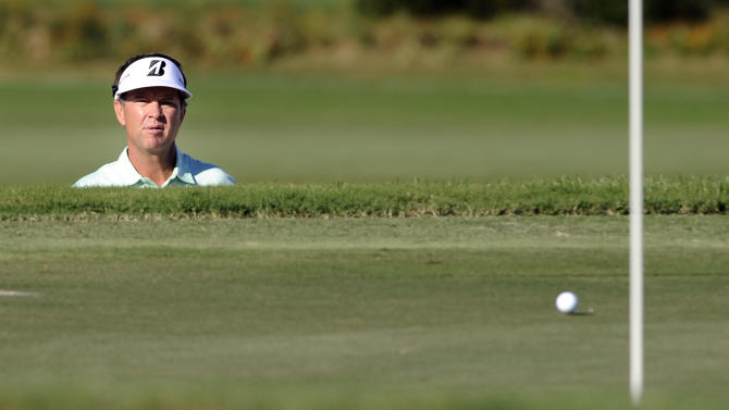 Davis Love III watches his ball roll past the hole after hitting from the bunker on the 15th green during the final round of the McGladrey Classic PGA Tour golf tournament on Sunday, Oct. 21, 2012, in St. Simons Island, Ga. (AP Photo/Stephen Morton)