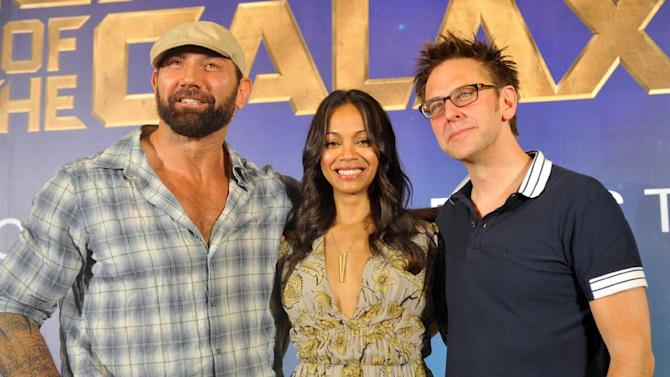Marvel's Guardians of the Galaxy Director Dave Bautista (L) and cast members Zoe Saldana (C) and James Gunn pose during a photo call at Marina Bay Sands in Singapore on July 10, 2014