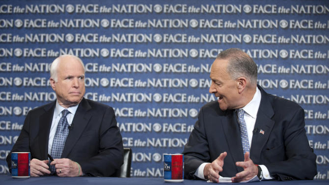 "In this photo provided by CBS News, Sen. John McCain, R-Ariz., and Sen. Chuck Schumer, D-N.Y., appear on Sunday, April 7, 2013, on CBS' ""Face the Nation."" McCain and Schumer spoke about gun legislation, the latest developments with North Korea and immigration, with Schumer saying he's hoping for a bipartisan deal by the end of this week on a sweeping immigration bill to secure the border and allow eventual citizenship to the estimated 11 million people living here illegally. (AP Photo/CBS News, Chris Usher)"