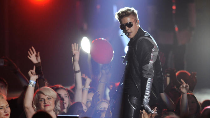Justin Bieber performs at the Billboard Music Awards at the MGM Grand Garden Arena on Sunday, May 19, 2013 in Las Vegas. (Photo by Chris Pizzello/Invision/AP)