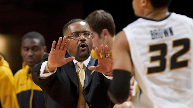 Missouri head coach Frank Haith, left, slows down player Jabari Brown, right, as he brings the ball up court  during the second half of an NCAA college basketball game against Vanderbilt, Wednesday, Feb. 19, 2014, in Columbia, Mo. Missouri won the game 67-64