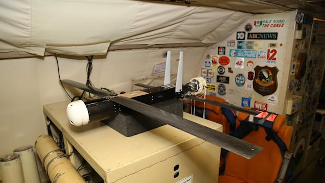 This Sept. 2014 photo provided by NOAA shows one of four drones ready to be released into Hurricane Edouard from a hurricane hunter plane flying over the Atlantic Ocean. Federal scientists are still analyzing the data from four drones launched into Hurricane Edouard this week, but Joe Cione, who studies how storms interact with the ocean at the National Oceanic and Atmospheric Administration's Hurricane Research Division in Miami, says the information they sent back is expected to provide unique and potentially groundbreaking insights into parts of tropical storms that are difficult to observe. (AP Photo/NOAA)