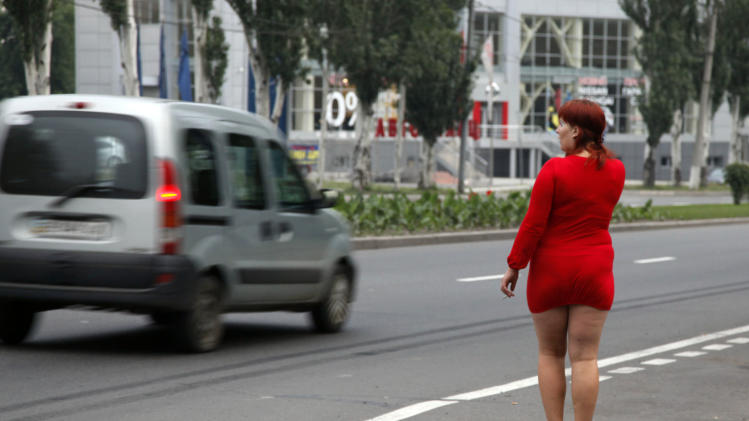 FILE - In this Oct.7, 2011 file photo, a sex worker searches for clients on a highway in Donetsk, Ukraine. Ahead of World AIDS day on Saturday, international organizations are exhorting the Ukrainian government to increase funding for treatment and do more to prevent the disease from spreading from high-risk groups into the mainstream population, where it is even harder to manage and control. (AP Photo/Efrem Lukatsky)