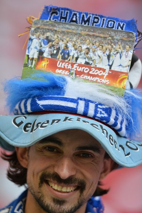 A Greek Fan Smiles AFP/Getty Images