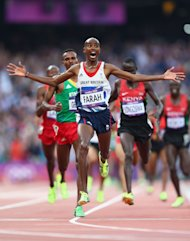 Mohamed Farah crosses the finish line to win gold in the Men&amp;#39;s 5000m Final (Getty Images)