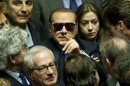 Former Italian Premier Silvio Berlusconi wears sunglasses as he attends the vote operations at the Senate, in Rome Saturday, March 16, 2013. Berlusconi was met with jeers from protesters as he arrived to take part in the Senate vote, a day after leaving a Milan hospital following a week's treatment for an eye inflammation. Before entering the Senate building, he turned to the protesters and said &quot;shame on you.&quot; Berlusconi has been seeking to have two trials  a tax fraud appeal and a sex-for-hire hearing  postponed due to the eye condition. The courts responded by dispatching court-appointed doctors to verify its severity. (AP Photo/Mauro Scrobogna) ITALY OUT