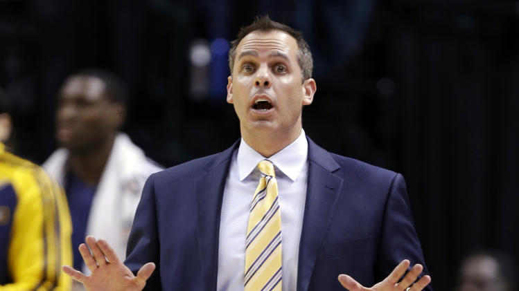 Indiana Pacers head coach Frank Vogel yells to his team in the second half of an NBA basketball game against the Miami Heat in Indianapolis, Tuesday, Dec. 10, 2013. The Pacers won 90-84. (AP Photo/Michael Conroy)