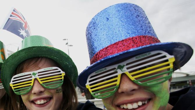 Two tennis fans wear colorful hats and glasses as part of Australia Day celebrations at the Australian Open 2015 tennis tournament in Melbourne