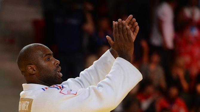 France's Teddy Riner celebrates after becoming World Champion for the eighth time, after he won the gold medal in the +100kg category competition at the Judo World Championships in Astana on August 29, 2015
