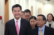 Hong Kong's new Chief Executive Leung Chun-ying (left), seen in Beijing in April. Hong Kong's anti-corruption watchdog said Thursday it had arrested a minister for allegedly abusing his housing allowances, plunging Leung's new government into scandal
