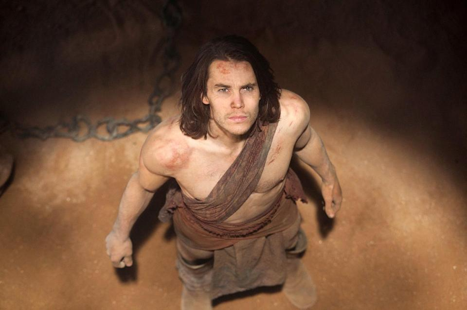 "In this film image released by Disney, Taylor Kitsch is shown in a scene from ""John Carter."" The Walt Disney Co. said Monday that it expects to book a loss of $200 million on the movie in the quarter through March. That's among Hollywood's biggest money-losers ever. (AP Photo/Disney, Frank Connor)"