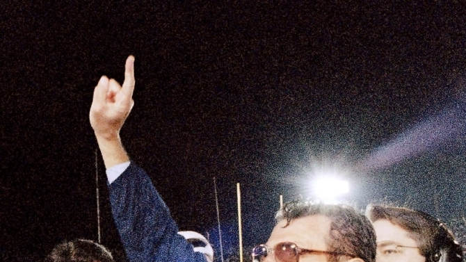 FILE - In this Jan. 2, 1995 file photo, Penn State head coach Joe Paterno smiles as he celebrates his team's victory over the University of Oregon in the Rose Bowl college game in Pasadena, Calif.  Paterno say he plans to retire at the end of the season, his long and illustrious career brought down because he failed to do all he could about an allegation of child sex abuse against a former assistant.  (AP Photo/Reed Saxon, File)