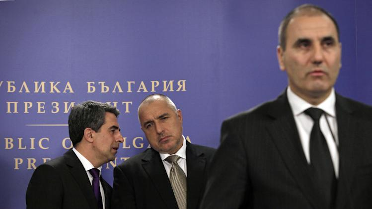 Bulgarian Interior Minister Tsvetan Tsvetanov, right, speaks during briefing, as Bulgarian President Plevneliev, left, talks to Bulgarian Prime Minister Borissov, after Consultative Council meeting on National Security at the Bulgarian President's office in Sofia, Tuesday, Feb. 5, 2013. Bulgarian officials say a Canadian and an Australian are suspects in a deadly bomb attack they say is linked to Lebanon's militant group Hezbollah. Interior Minister Tsvetan Tsevtnov says two of the suspects in the attack that killed five Israeli tourists last July had entered the country with an Australian and a Canadian passport. (AP Photo/Valentina Petrova)