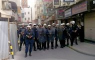 A handout picture released by al-Wefaq Media Centre shows Bahraini riot police standing guard in the street in the capital, Manama, during a pro-democracy demonstration