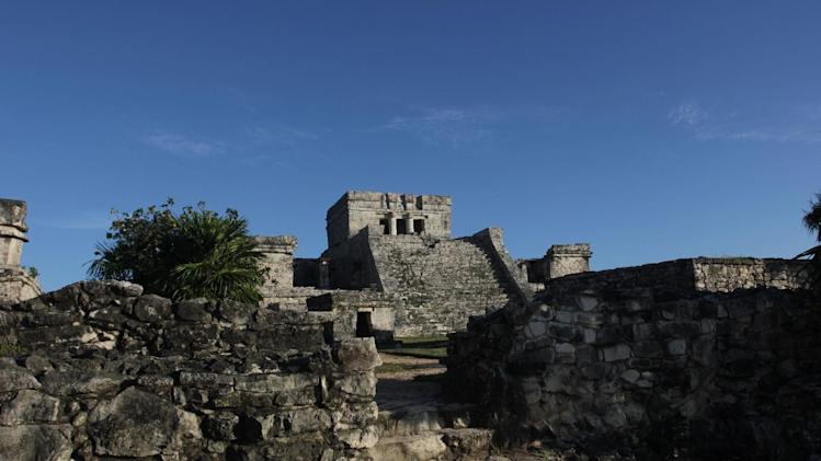 In this Jan. 4, 2013, photograph, the Castle of the Mayan ruins in Tulum, Mexico is lit by late afternoon sun. Tulum may be best-known for its ancient Mayan ruins, which attract a steady stream of day-trippers, cruise passengers and tour buses. The complex of crumbling structures here is smaller and less impressive than some other Mayan sites like Chichen Itza, but its location atop seaside cliffs is one of the most scenic ruin sites on the Yucatan. (AP Photo/Manuel Valdes)