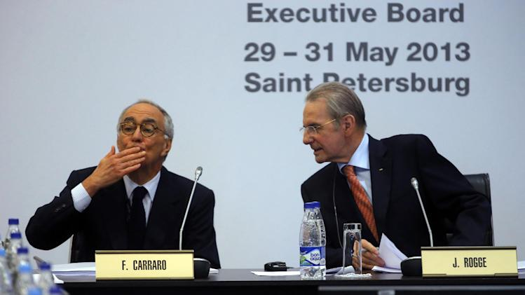 IOC President Jacques Rogge, right, and IOC member Franco Carraro, of Italy, attend the IOC executive board meeting at the SportAccord International Convention in St.Petersburg, Russia, Wednesday, May 29, 2013. (AP Photo/Dmitry Lovetsky)