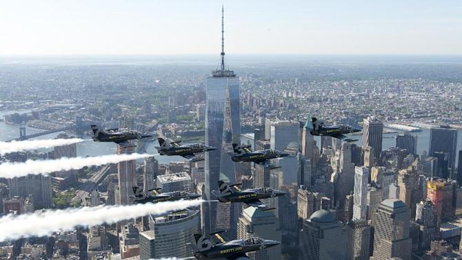 IMAGE DISTRIBUTED FOR BREITLING - The Breitling Jet Team fly in formation over the new Freedom Tower at the World Trade Center in New York City, USA. The team, based in Dijon, France, who represent the independent Swiss watch company Breitling, are embarking on their first-ever American Tour, comprised of nearly 20 air shows across the US and Canada. Made up of seven L-39C Albatros jets that can reach speeds of up to 565 mph (909 kph), the Breitling Jet Team is the world's largest professional civilian jet flight team. In addition to the new Freedom Tower at the World Trade Center, the Team took in other New York landmarks including the Statue of Liberty, Central Park and the George Washington Bridge. (Andy Wolfe/Breitling via AP Images)