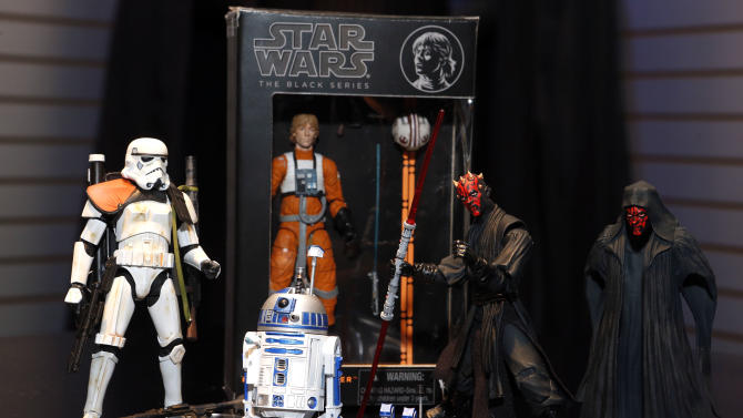 The new STAR WARS BLACK SERIES 6-inch action figures, featuring highly detailed collectible figures in a new scale, are displayed in Hasbro's showroom at the American International Toy Fair, Saturday, Feb. 9, 2013, in New York. (Photo by Jason DeCrow/Invision for Hasbro/AP Images)