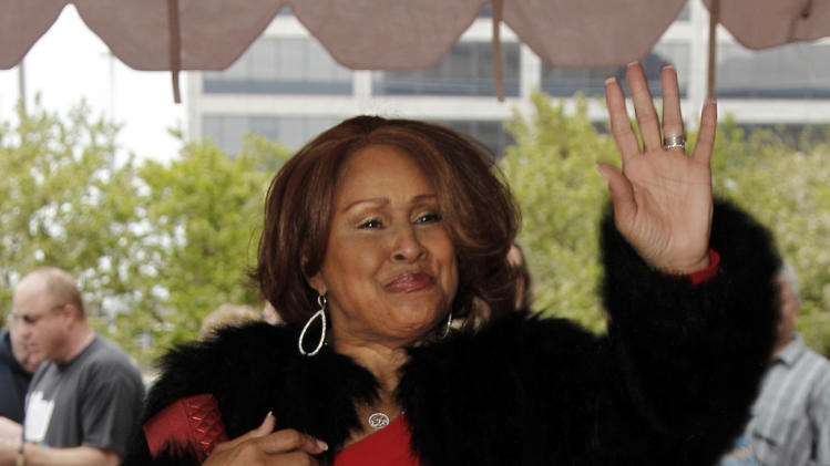 Singer Darlene Love waves from the red carpet before the 2012 Rock and Roll Hall of Fame induction ceremony in Cleveland on Saturday, April 14, 2012. (AP Photo/Amy Sancetta)