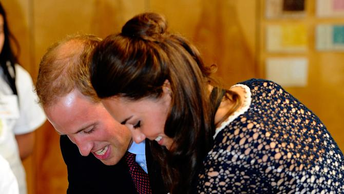 Prince William and Kate, the Duke and Duchess of Cambridge, make hand prints in clay during a tour of Inner City Arts Sunday July 10, 2011 in the Skid Row section of Los Angeles. (AP Photo/Kevork Djansezian, Pool)
