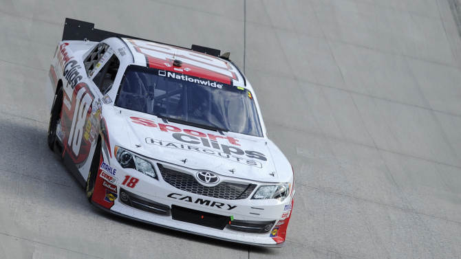 Joey Logano (18) drives during the NASCAR Nationwide Series auto race, Saturday, Sept. 29, 2012, at Dover International Speedway in Dover, Del. Logano won the race. (AP Photo/Nick Wass)