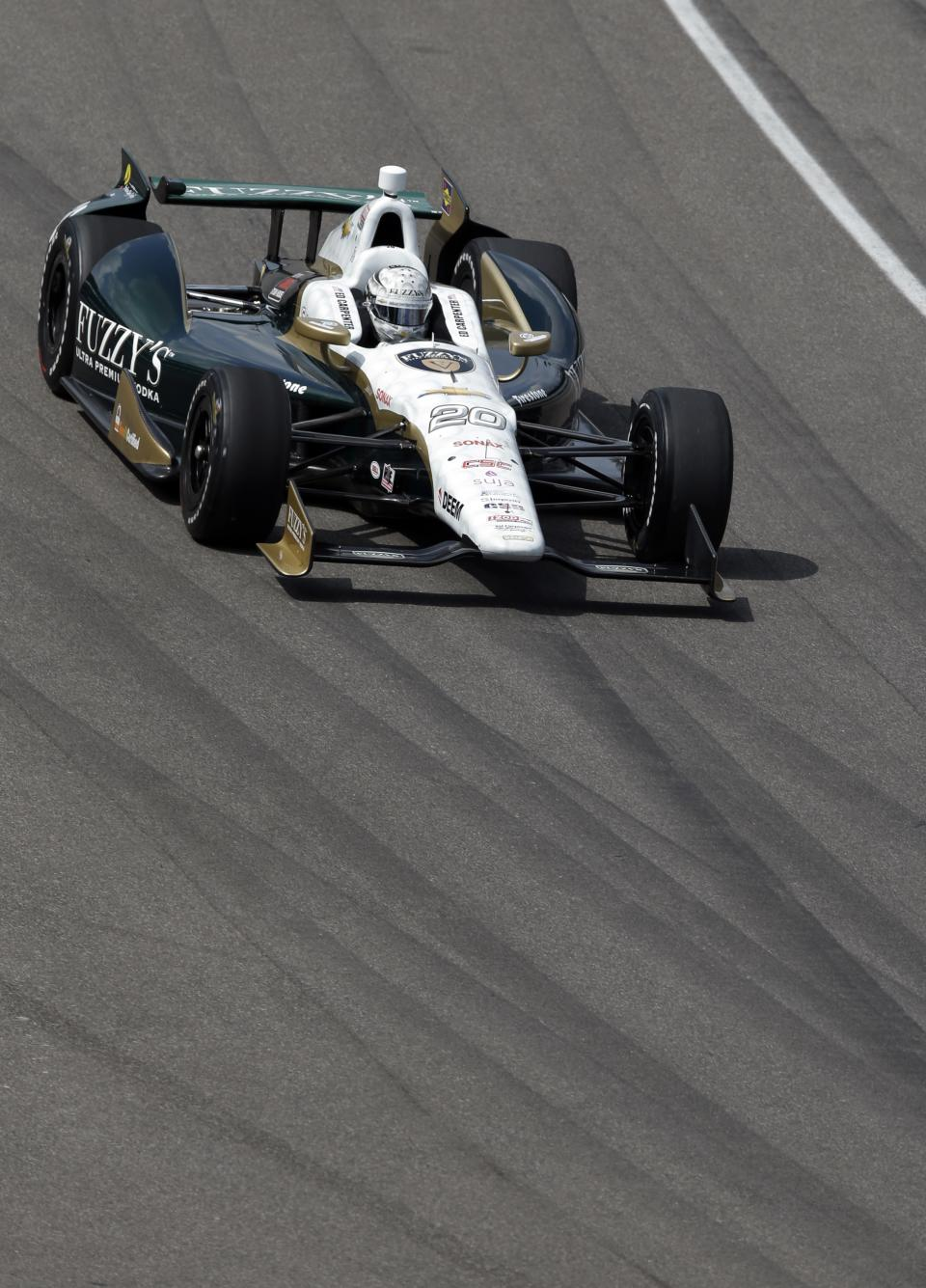 Ed Carpenter heads into the first turn during a practice session on the second day of qualifications for the Indianapolis 500 auto race at the Indianapolis Motor Speedway in Indianapolis Sunday, May 19, 2013. (AP Photo/Darron Cummings)