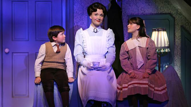 """FILE - This file theater publicity image provided by Disney Theatricals shows, from left, Neil McCaffrey, Scarlett Strallen and Cassady Leonard in a scene from """"Mary Poppins,"""" in New York. The six-year old musical will end performances in March at the New Amsterdam Theatre and eventually be replaced by a musical adapted from the film """"Aladdin."""" (AP Photo/Disney Theatricals, Joan Marcus)"""