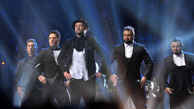 This image released by MTV shows, from left, Lance Bass, JC Chasez, Justin Timberlake, Joey Fatone and Chris Kirkpatrick, of 'N Sync, at the MTV Video Music Awards at Barclays Center on Sunday, Aug. 25, 2013, in the Brooklyn borough of New York. (AP Photo/ MTV, John Shearer)