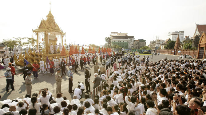 The Royal funeral procession, carrying the casket of Cambodia's late former King Norodom Sihanouk, parade through the crowd Friay, Feb. 1, 2013, in Phnom Penh, Cambodia.  The cremation ceremony of the former king will be held on Feb. 4. (AP Photo/Heng Sinith)