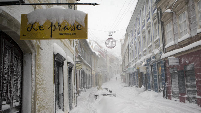 A street is covered by snow in downtown Zagreb, Saturday, Dec. 8, 2012. Parts of eastern and central Europe were hit hard by heavy snow and freezing temperatures. (AP Photo/Darko Bandic)
