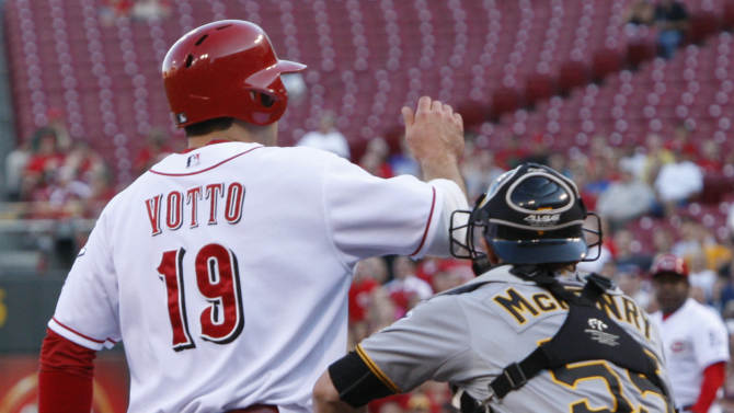 Pittsburgh Pirates catcher Michael McKenry (55) tags out Cincinnati Reds' Joey Votto (19) at home plate in the first inning of a baseball game, Thursday, June 7, 2012 in Cincinnati. (AP Photo/Al Behrman)