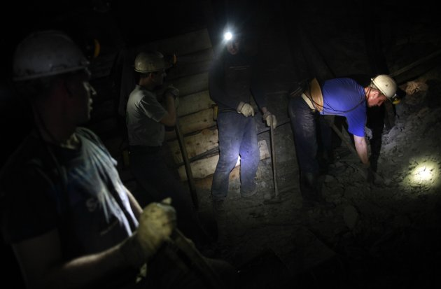 Coal miners work in a coal mine in Breza