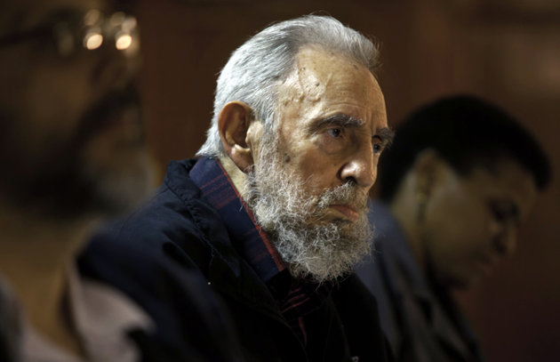 In this Feb. 10, 2012 file photo released by the state media website Cubadebate, Fidel Castro attends a meeting with intellectuals and writers at the International Book Fair in Havana, Cuba.  Castro t
