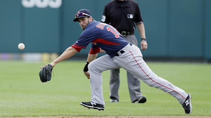 CORRECTS POSITION TO SECOND BASEMAN, NOT SHORTSTOP  - Boston Red Sox second baseman Jeff Bianchi chases a single by Atlanta Braves' Pedro Ciriaco during the first inning of a spring training exhibition baseball game in Kissimmee, Fla., Friday, March 27, 2015. (AP Photo/Carlos Osorio)