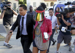 Model who uses the name V. Stiviano walks outside her home in Los Angeles