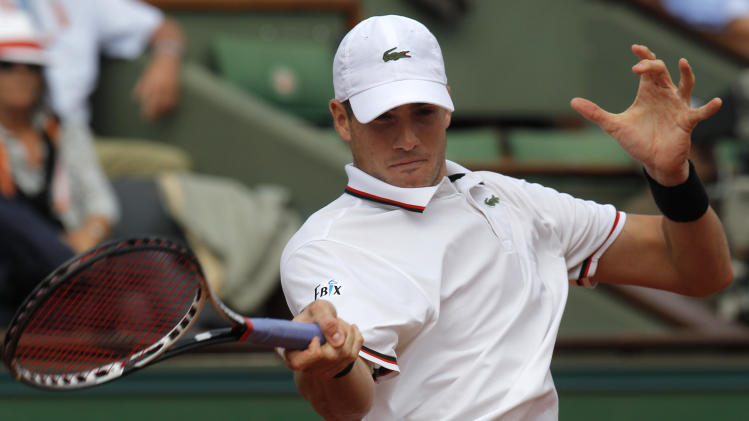 USA's John Isner returns the ball to France's Paul-Henri Mathieu during their second round match in the French Open tennis tournament at the Roland Garros stadium in Paris, Thursday, May 31, 2012. (AP Photo/Michel Euler)