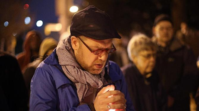 Michael Patter, senior minister at Central Congregational United Church of Christ, prays silently during a vigil for Kelly Gissendaner and protest against the death penalty Monday, March 2, 2015, on the steps of the State Capitol. Patter said he is scheduled to preside over Gissendaner's memorial service after she is executed. (AP Photo/Atlanta Journal-Constitution, Ben Gray)