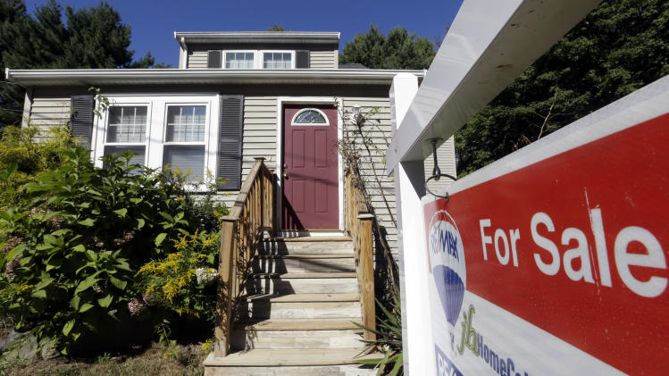 """FILE - In this Wednesday, Sept. 18, 2013, file photo, a """"For Sale"""" sign hangs in front of a house in Walpole, Mass. Standard & Poor's/Case-Shiller reports on U.S. home prices in September, on Tuesday, Nov. 26, 2013. (AP Photo/Steven Senne, File)"""