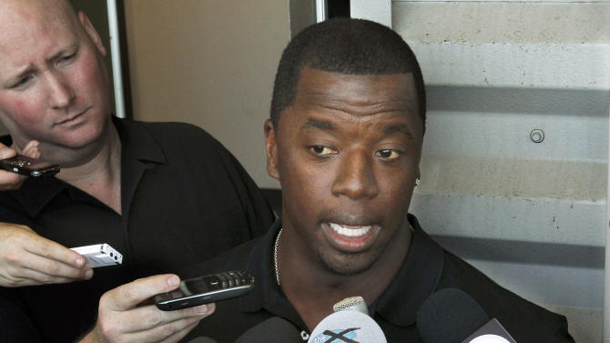 """FILE - This May 30, 2012 file photo shows former NFL quarterback Kordell Stewart talking with reporters about retiring from the Pittsburgh Steelers at the team's headquarters in Pittsburgh. Stewart has filed for divorce from his reality television star wife. In a divorce petition filed Friday in Fulton County Superior Court in Atlanta, Stewart says his marriage to Porsha Williams is """"irretrievably broken"""" and the two are separated. The pair appears on Bravo's """"The Real Housewives of Atlanta."""" The filing says the two married on May 21, 2011, and have no children together. (AP Photo/Keith Srakocic, file)"""